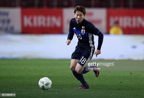 Takuma Asano of Japan in action during the international friendly match between Japan and Oman at Kashima Soccer Stadium on November 11 2016 in...