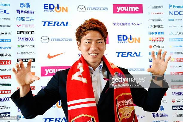 Takuma Asano of Sanfrecce Hiroshima poses for photographs during a press conference announcing his move to Arsenal on July 4 2016 in Hiroshima Japan