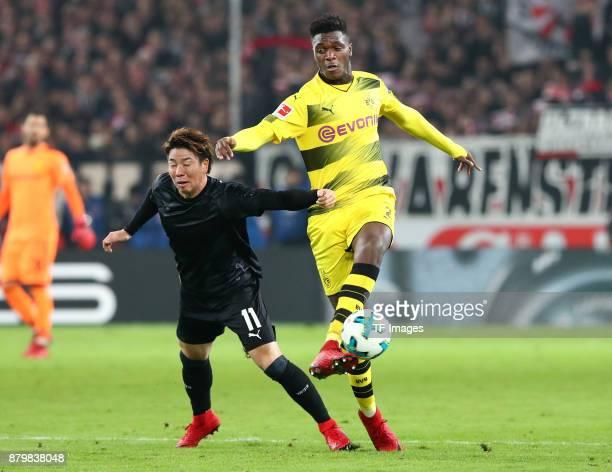 Takuma Asano of Stuttgart and DanAxel Zagadou of Dortmund battle for the ball during the Bundesliga match between VfB Stuttgart and Borussia Dortmund...