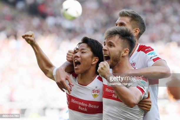 Takuma Asano of Stuttgart celebrates his team's second goal with team mates Alexandru Maxim and Simon Terodde during the Second Bundesliga match...