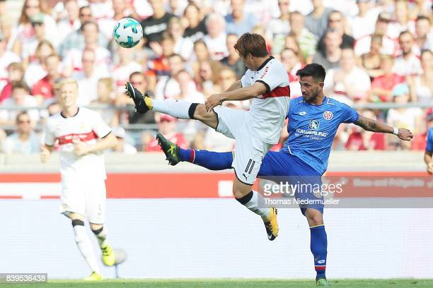 Takuma Asano of Stuttgart fights for the ball with Danny Latza of Mainz during the Bundesliga match between VfB Stuttgart and 1 FSV Mainz 05 at...