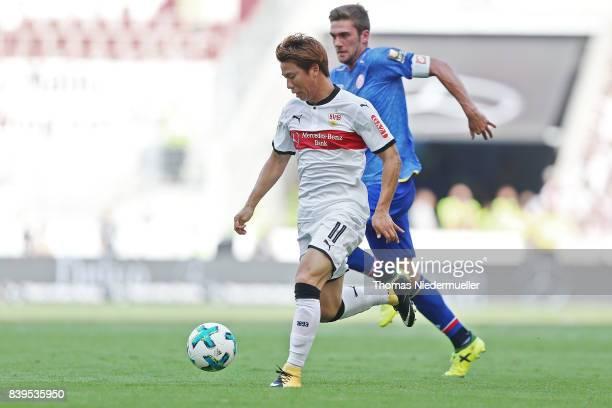 Takuma Asano of Stuttgart fights for the ball with Stefan Bell of Mainz during the Bundesliga match between VfB Stuttgart and 1 FSV Mainz 05 at...