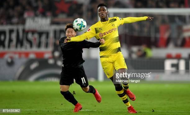 Takuma Asano of Stuttgart is challenged by Dan Axel Zagadou of Dortmund during the Bundesliga match between VfB Stuttgart and Borussia Dortmund at...