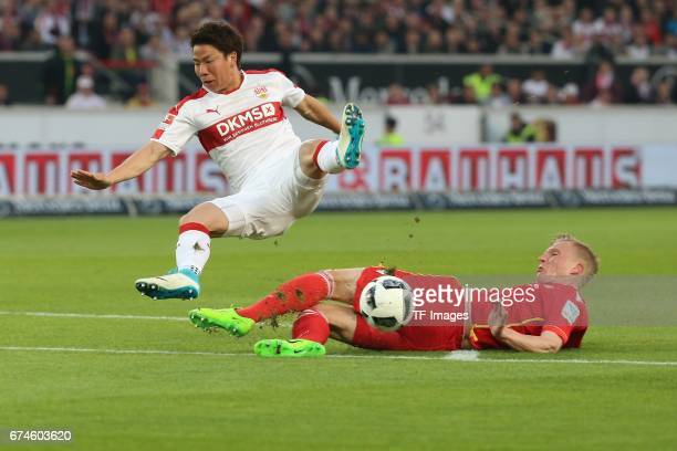 Takuma Asano of Stuttgart Kristian Pedersen of Union Berlin battle for the ball during the Second Bundesliga match between VfB Stuttgart and 1 FC...