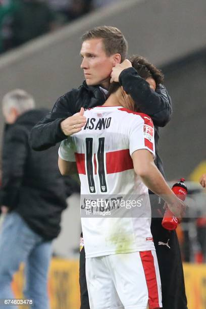 Takuma Asano of Stuttgart shakes hands with Head coach Hannes Wolf of Stuttgart during the Second Bundesliga match between VfB Stuttgart and 1 FC...