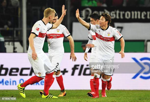 Takuma Asano of VfB Stuttgart is congratulated after scoring a goal during the Bundesliga match between Hannover 96 and VfB Stuttgart at HDIArena on...
