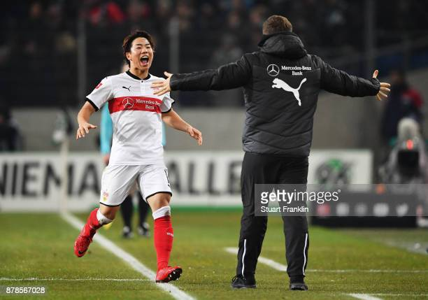 Takuma Asano of VfB Stuttgart is congratulated by Hannes Wolf head coach of VfB Stuttgart after scoring a goal during the Bundesliga match between...