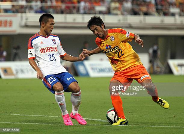 Takuma Edamura of Shimizu SPulse and Kei Koizumi of Albirex Niigata compete for the ball during the JLeague match between Shimizu SPulse and Albirex...