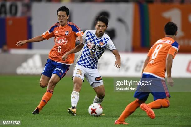 Takuma Nishimura of Vegalta Sendai and Ryota Isomura of Albirex Niigata compete for the ball during the JLeague J1 match between Albirex Niigata and...