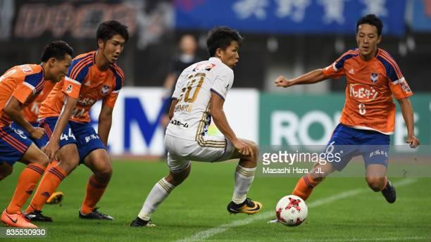 Takuma Nishimura of Vegalta Sendai controls the ball under pressure of Albirex Niigata defense during the JLeague J1 match between Albirex Niigata...