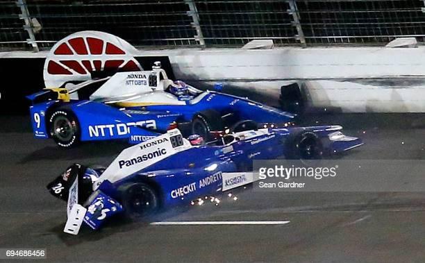Takuma Sato driver of the Andretti Autosport Honda and Scott Dixon driver of the NTT Data Chip Ganassi Racing Honda collide during the Verizon...