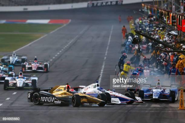 Takuma Sato driver of the Andretti Autosport Honda Helio Castroneves driver of the AAA Insurance Team Penske Chevrolet and James Hinchcliffe driver...