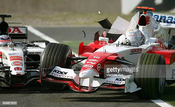 Takuma Sato of Japan and BAR Honda crashes into Jarno Trulli of Italy and Toyota during the F1 Grand Prix of Japan on October 9 2005 in Suzuka Japan