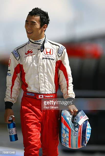 Takuma Sato of Japan and Super Aguri F1 walks down the pitlane during practice prior to qualifying for the European Grand Prix at Nurburgring on July...