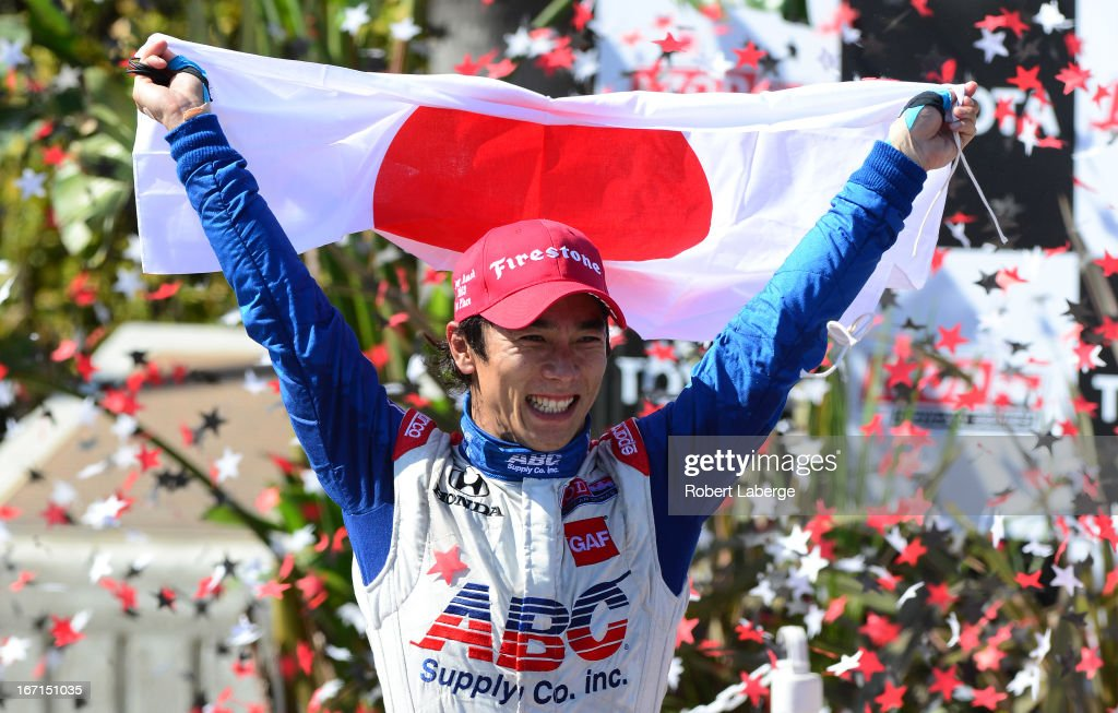 <a gi-track='captionPersonalityLinkClicked' href=/galleries/search?phrase=Takuma+Sato&family=editorial&specificpeople=203006 ng-click='$event.stopPropagation()'>Takuma Sato</a> of Japan driver of the #14 ABC Supply A. J. Foyt Racing Dallara Honda celebrates after winning the IndyCar Series Toyota Grand Prix of Long Beach on April 21, 2013 on the streets of Long Beach, California.
