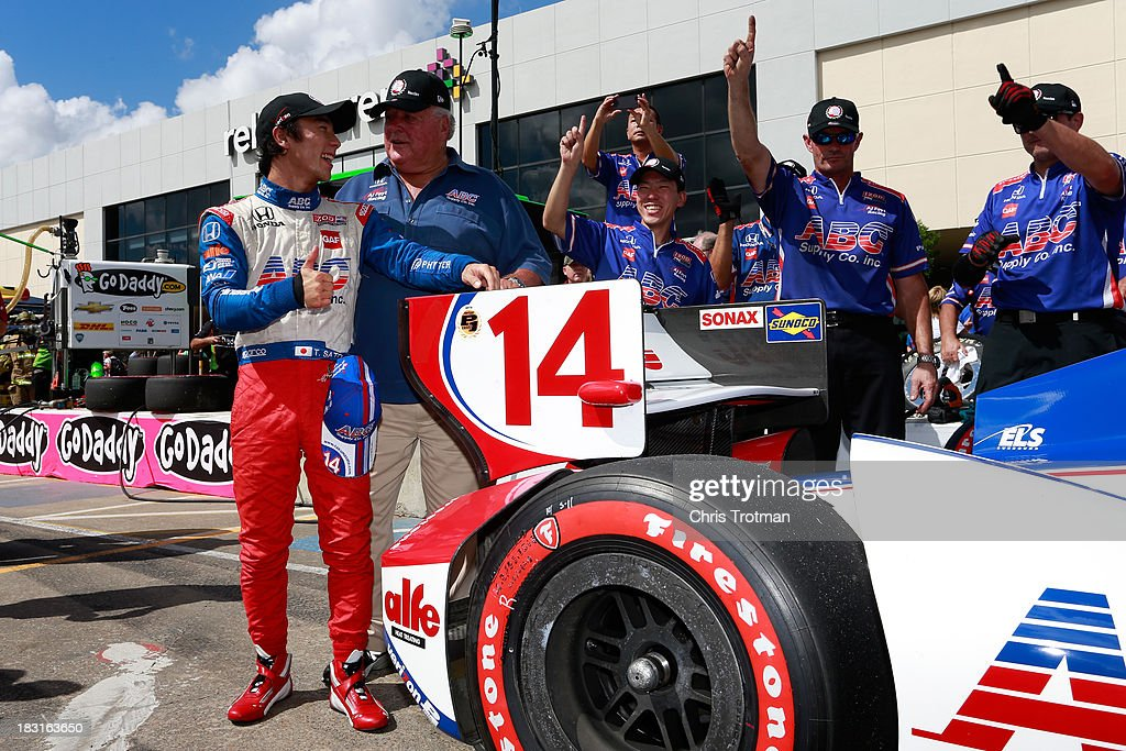 <a gi-track='captionPersonalityLinkClicked' href=/galleries/search?phrase=Takuma+Sato&family=editorial&specificpeople=203006 ng-click='$event.stopPropagation()'>Takuma Sato</a> (L) of Japan, driver of the #14 ABC Supply A. J. Foyt Racing Honda Dallara and team owner (R) <a gi-track='captionPersonalityLinkClicked' href=/galleries/search?phrase=A.J.+Foyt&family=editorial&specificpeople=213622 ng-click='$event.stopPropagation()'>A.J. Foyt</a> pose with the Verizon P1 Award in pit lane following qualifying for the IZOD IndyCar Series Shell and Pennzoil Grand Prix Of Houston at Reliant Park on October 5, 2013 in Houston, Texas.