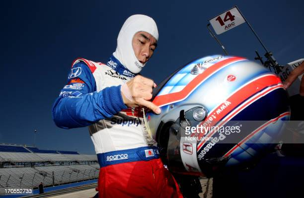 Takuma Sato of Japan driver of the ABC Supply AJ Foyt Racing Honda prepares for practice for the Milwaukee IndyFest at the Milwaukee Mile on June 14...