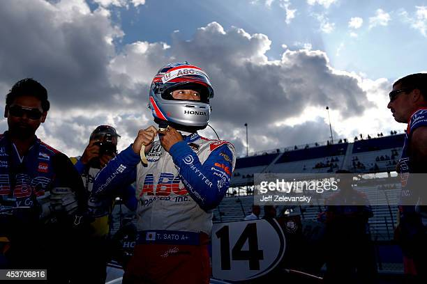 Takuma Sato of Japan driver of the ABC Supply AJ Foyt Racing Honda stands on the grid during qualifying for the ABC Supply Wisconsin 250 at The...