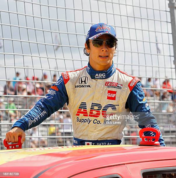 Takuma Sato of Japan driver of the AJ Foyt Enterprises car before the IZOD IndyCar Series Shell and Pennzoil Grand Prix Of Houston Race 1 at Reliant...