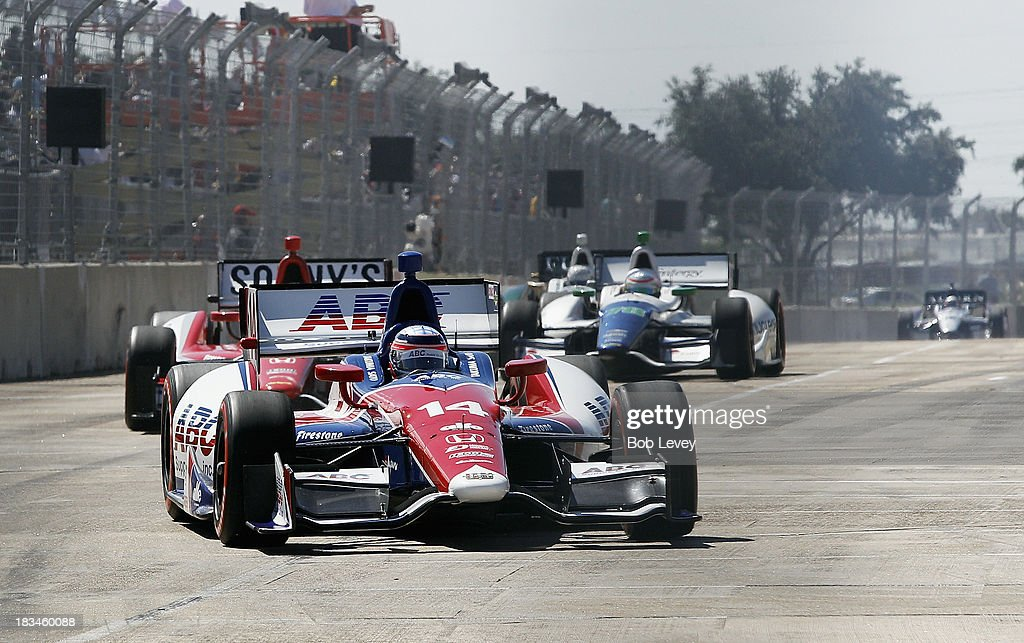 <a gi-track='captionPersonalityLinkClicked' href=/galleries/search?phrase=Takuma+Sato&family=editorial&specificpeople=203006 ng-click='$event.stopPropagation()'>Takuma Sato</a> of Japan, driver of the #14 A.J. Foyt Enterprises car races down the straightaway at Shell And Pennzoil Grand Prix Of Houston Race #2 at Reliant Park on October 6, 2013 in Houston, Texas.