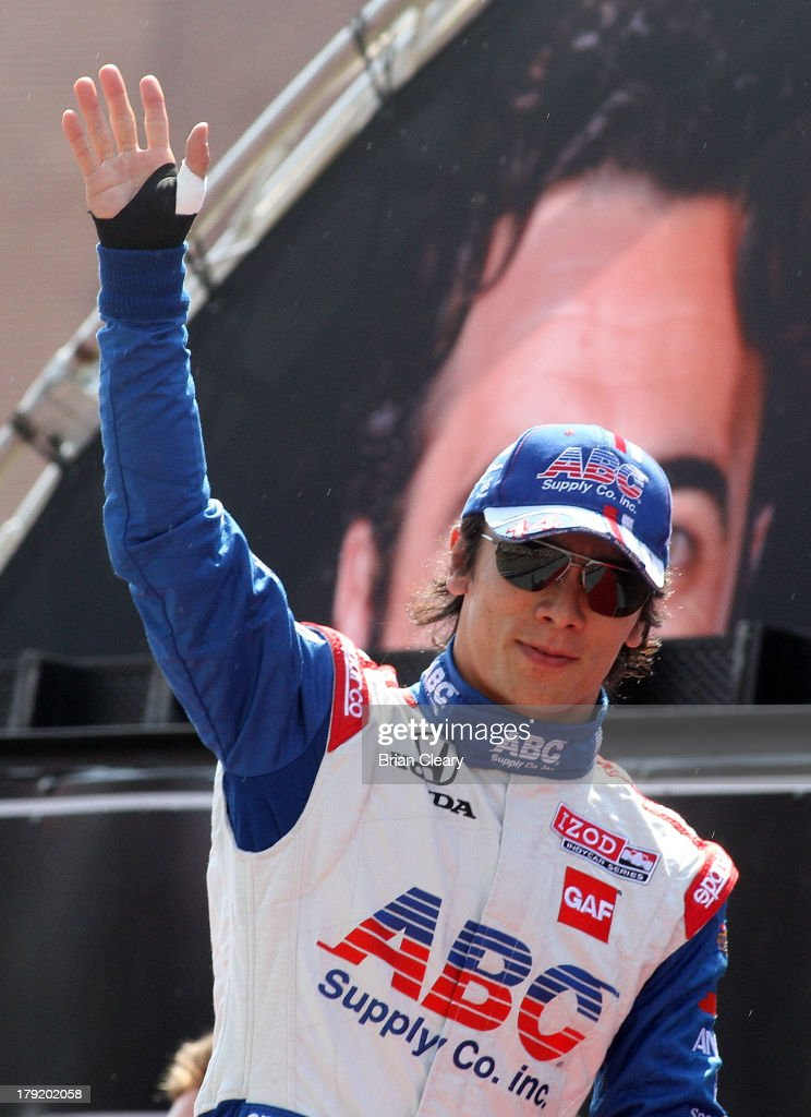 Takuma Sato, of Japan, driver of the #14 A.J. Foyt Enterprises Honda Dallara waves to fans before the Grand Prix of Baltimore on September 1, 2013 in Baltimore, Maryland.