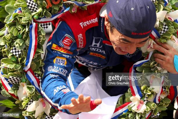 Takuma Sato of Japan driver of the Andretti Autosport Honda celebrates after winning the 101st Indianapolis 500 at Indianapolis Motorspeedway on May...