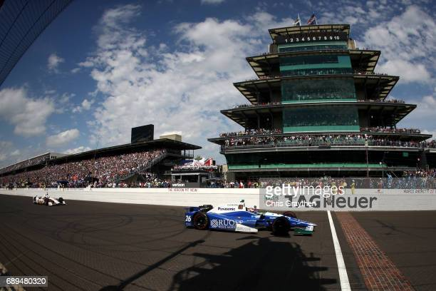 Takuma Sato of Japan driver of the Andretti Autosport Honda crosses the finish line to win the 101st Indianapolis 500 at Indianapolis Motorspeedway...