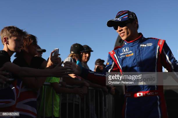 Takuma Sato of Japan driver of the Andretti Autosport Honda greets fans as he is introduced to the Desert Diamond West Valley Phoenix Grand Prix at...