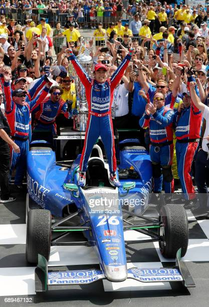 Takuma Sato of Japan driver of the Andretti Autosport Honda celebrates in Victory Lane after winning the 101st running of the Indianapolis 500 at...