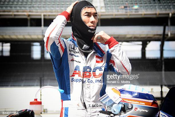 Takuma Sato of Japan driver of the Honda IndyCar looks on during practice at the Indianapolis Motorspeedway on May 18 2016 in Indianapolis Indiana