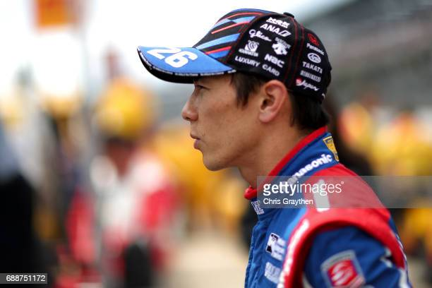 Takuma Sato of Japan driver of the Panasonic Honda stands on the grid during Carb day for the 101st Indianapolis 500 at Indianapolis Motorspeedway on...
