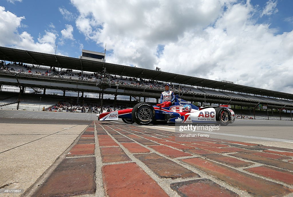 Takuma Sato of Japan, driver of ther #14 ABC Supply AJ Foyt Enterprises Honda Dallara poses for a photo after qualifying for the 98th Indianapolis 500 Mile Race on May 17, 2014 at the Indianapolis Motor Speedway in Indianapolis, Indiana.