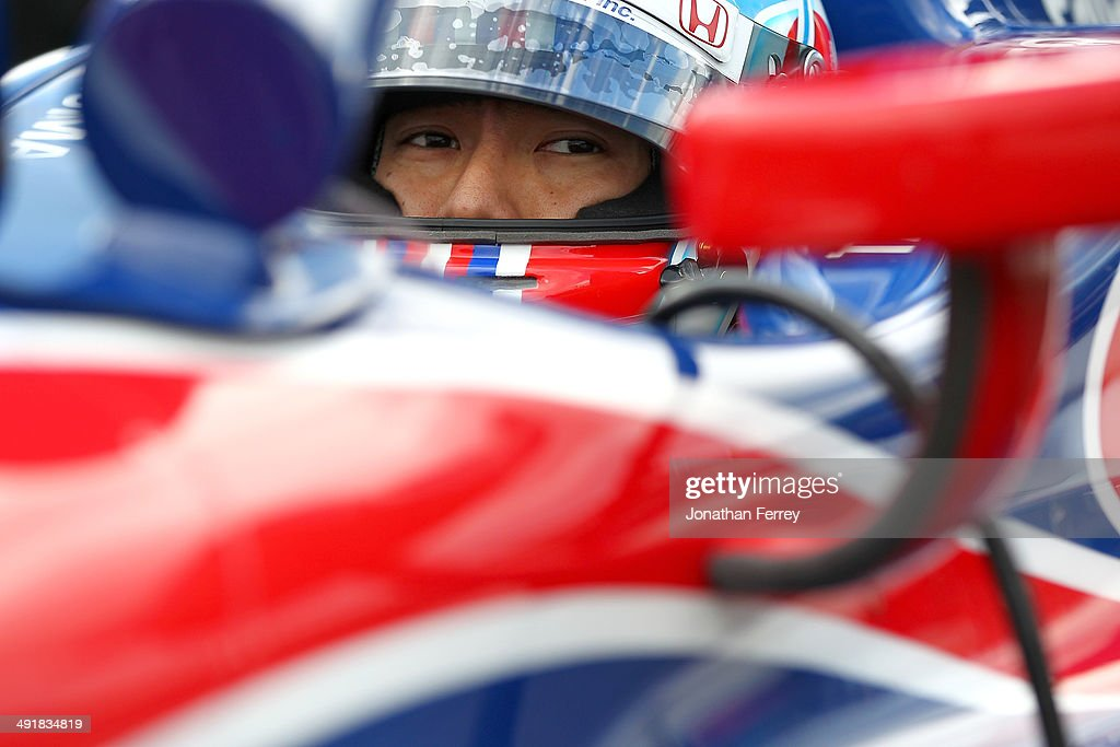 Takuma Sato of Japan, driver of ther #14 ABC Supply AJ Foyt Enterprises Honda Dallara waits to qualifyfor the 98th Indianapolis 500 Mile Race on May 17, 2014 at the Indianapolis Motor Speedway in Indianapolis, Indiana.
