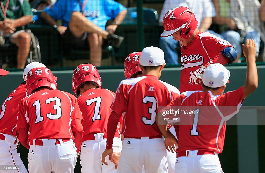 Takuma Takahashi #18 of Team Japan celebrates after hitting a solo home run against the West Team from Las Vegas, Nevada during fourth inning of the Little League World Series third place game at Lamade Stadium on August 24, 2014 in South Williamsport, Pennsylvania.