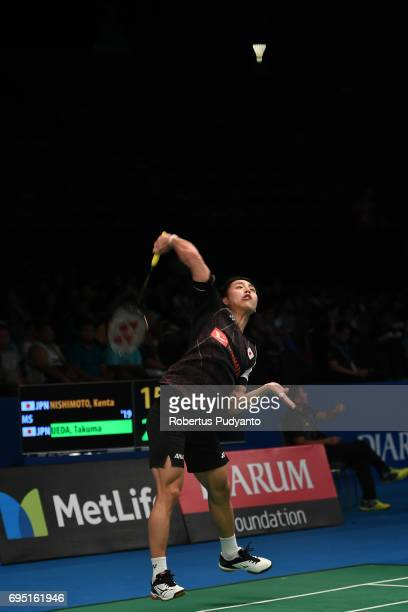 Takuma Ueda of Japan competes against Kenta Nishimoto of Japan during Mens single qualification round match of the BCA Indonesia Open Super Series...