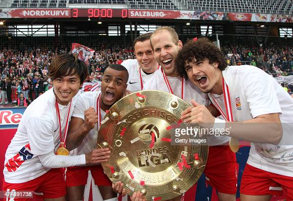 Takumi Minamino Felipe Pires Peter Ankersen Peter Gulacsi and Andre Ramalho of Salzburg celebrate with the trophy for winning the Austrian Soccer...