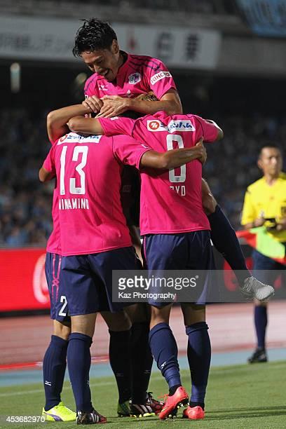 Takumi Minamino of Cerezo Osaka celebrates scoring his team's first goal with his teammates during the JLeague match between Kawasaki Frontale and...