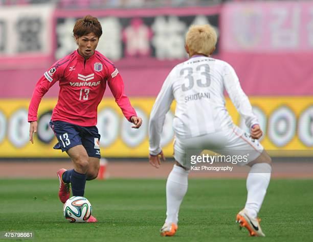 Takumi Minamino of Cerezo Osaka Dribbles the ball to Tsukasa Shiotani of Sanfrecce Hiroshima during the J League match between Cerezo Osaka and...
