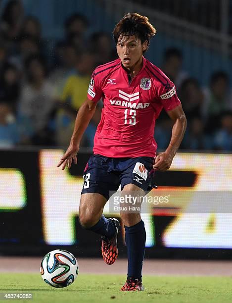 Takumi Minamino of Cerezo Osaka in action during the JLeague match between Kawasaki Frontale and Cerezo Osaka at Todoroki Stadium on August 16 2014...