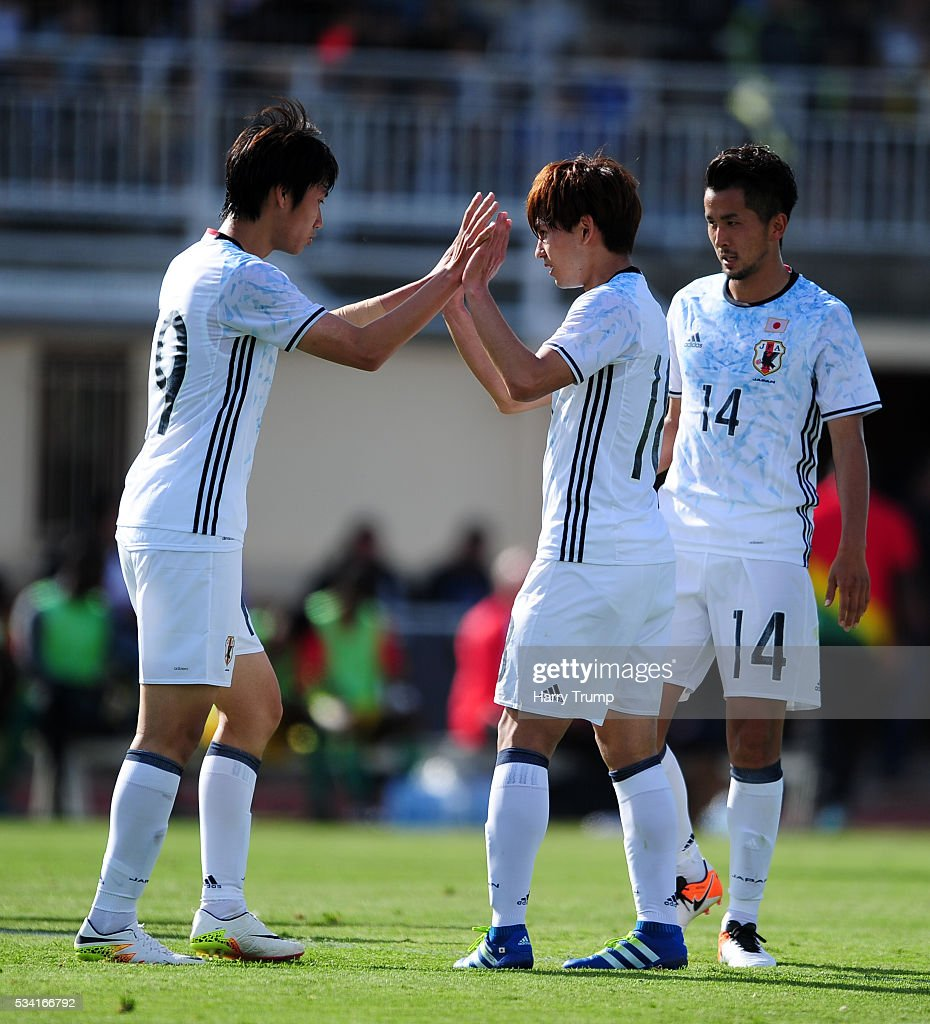 Takumi Minamino of Japan(C) celebrates after scoring his sides second goal during the Toulon Tournament match between Guinea and Japan at Stade Antoinr Baptiste on May 25, 2016 in Six-Fours-Les-Plages, France.