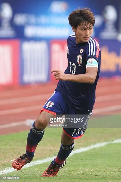 Takumi Minamino of Japan in action during the AFC U19 Championship quarterfinal match between Japan and North Korea at Wunna Theikdi Stadium on...