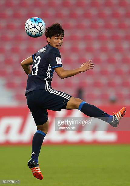 Takumi Minamino of Japan in action during the AFC U23 Championship Group B match between Japan and North Korea at Grand Hamad Stadium on January 13...