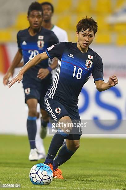 Takumi Minamino of Japan in action during the AFC U23 Championship Group B match between Saudi Arabia and Japan at Suhaim Bin Hamad Stadium on...