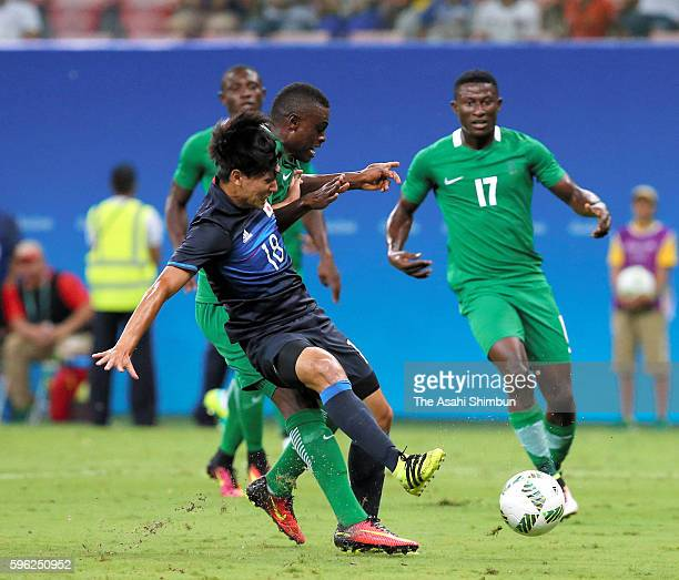 Takumi Minamino of Japan is fouled in the area resulting in the penalty kick during the 2016 Summer Olympics match between Japan and Nigeria at Arena...