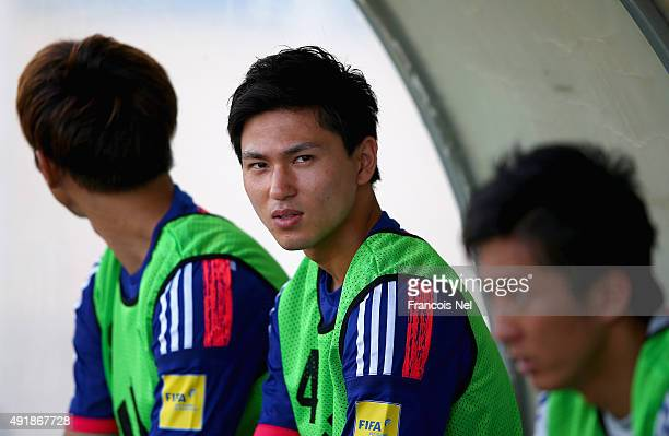 Takumi Minamino of Japan looks on prior to the start of the 2018 FIFA World Cup Asian Group E qualifying match between Syria and Japan at Seeb...