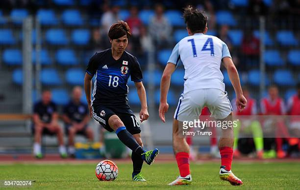 Takumi Minamino of Japan looks to break past Jack Grealish of England during the Toulon Tournament match between Japan and England at the Stade Leo...