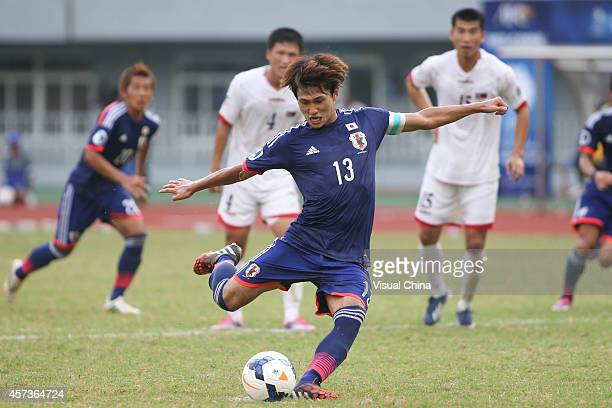 Takumi Minamino of Japan scores the equalizing goal with a penalty during the AFC U19 Championship quarterfinal match between Japan and North Korea...