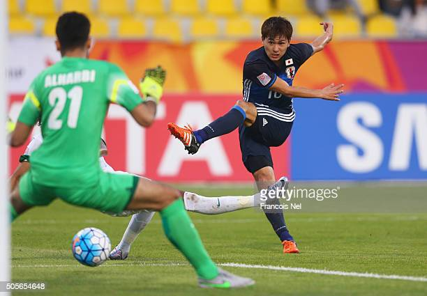 Takumi Minamino of Japan shoots at goalkeeper Ahmad Alharbi of Saudi Arabia during the AFC U23 Championship Group B match between Saudi Arabia and...