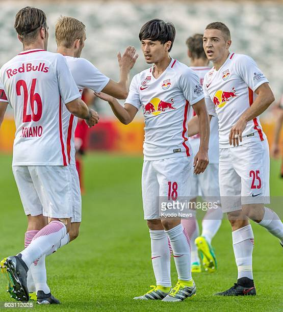 Takumi Minamino of Red Bull Salzburg celebrates with teammates after scoring his second goal during the second half of an Austrian Bundesliga match...