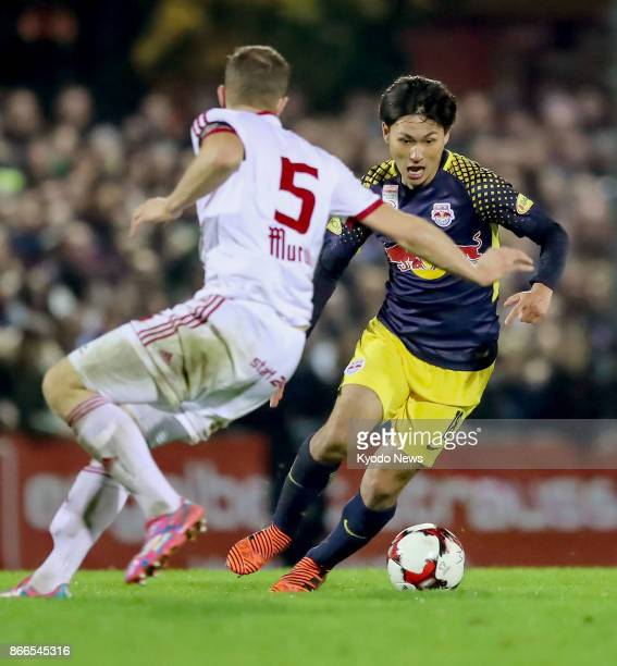 Takumi Minamino of Red Bull Salzburg vies for the ball during the second half of a thirdround Austrian Cup game against Bad Gleichenberg in Bad...
